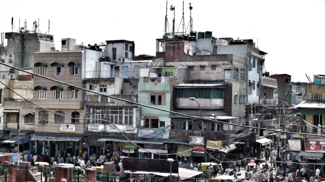 Family vacation photo of a city in India with an excessive number of obsolete power and communications lines presenting a dangerous environment for citizens.